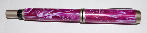 Pen with top