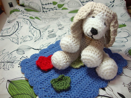 A small crocheted puppy