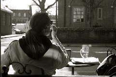 One more cup of coffee [19/365] (Sarah Ross photography) Tags: coffee smoker smoking water glass light sunlight ponytail hoodie blackandwhite brick williamsburg cw colonialwilliamsburg coffe aromas table outside coffeeshop wire sunglasses sarahr89 365 project365 19 sarahrossphotography bw shadow lights bright lighting contrast dark 2010 monochrome