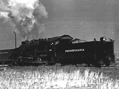 PRR Class C1 eight-wheeled switcher(0-8-0).  The Pennsy did not build an eight-wheeled switcher from 1880 or so until the mid 1920's.  The C1's were among the largest of the type ever built.