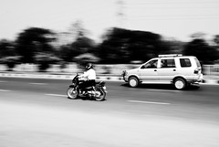 Rat Race 1 (Jogeshwar) Tags: road street bw white motion black blur chevrolet monochrome car lens blackwhite nikon highway vehicles motorbike vehicle van 1855 nikkor panning herohonda panned jogeshwar d3000