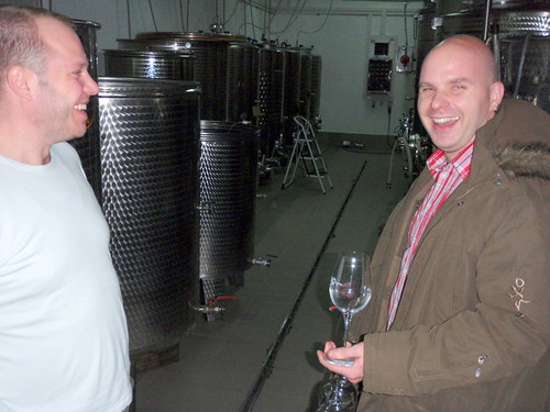 In the cellar with stainless steel vats