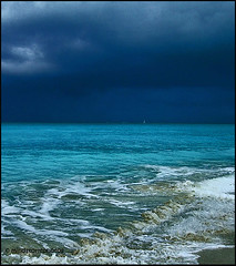 Stormy Weather in the Caribbean (Mindstormphotos) Tags: travel blue winter sea sky seascape storm beach water clouds geotagged island photography holidays image photos clean caribbean turksandcaicos gpc travelphotography northatlanticocean caribbeanislands theunforgettablepictures caribbeanimages daaarklands magicunicornverybest magicunicornmasterpiece