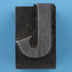 metal type letter J