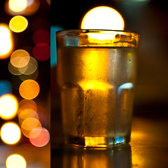 A Glass Of Bokeh (michaeljosh) Tags: light reflections gold diptych bokeh refreshing alfresco goldenlight nikkor50mmf14d glassofwater dinnerwithfamily project365 nikond90 michaeljosh aglassofbokeh