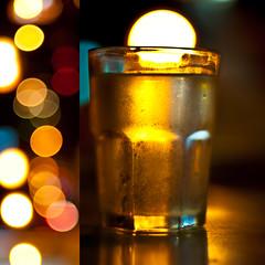 A Glass Of Bokeh (michaeljosh) Tags: light reflections gold diptych bokeh refreshing alfresco goldenlight nikkor50mmf14d glassofwater dinnerwithfamily project365 nikond90 michaeljosh aglassofbokeh