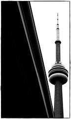 CN Tower B&W (Matt Lazzarini) Tags: city bridge blackandwhite bw toronto ontario canada tower monochrome contrast radio highway cntower symbol landmark olympus spire saturation expressway phallus gardner 43 oly gardinerexpressway blogto 1445mm e520 goldstaraward