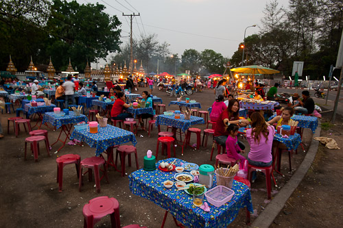 Tables at Vientiane's Pha That Luang Evening Market, Laos