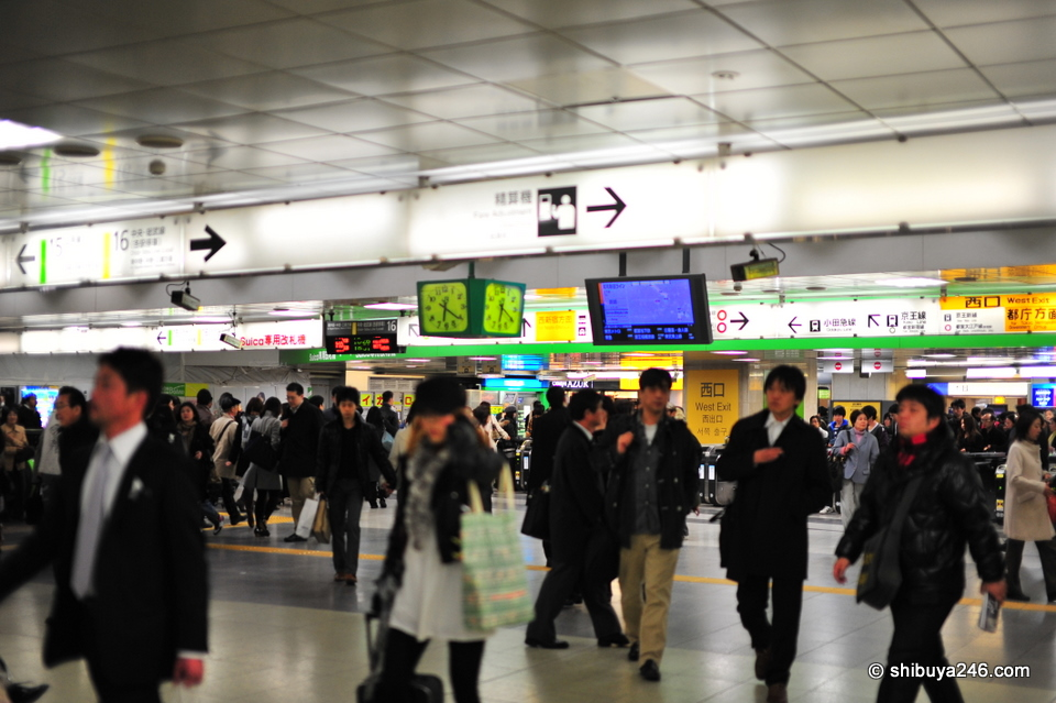 Some people coming, others going. Always plenty of action at Shinjuku Station.