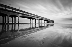 Both sides of the pier (Stu Meech) Tags: bw white black wet clouds silver reflections pier sand nikon soft long exposure tide low sigma lee pro fx streaked 1020mm boscombe nd110 06nd d300s