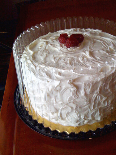 White cake with raspberry filling and vanilla buttercream