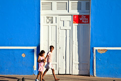 Nicaragua-091208-102 (Kelly Cheng) Tags: street travel people color colour building tourism girl sunshine shop horizontal architecture daylight colorful day doors child outdoor vivid sunny granada nicaragua colourful copyspace persons centralamerica traveldestinations