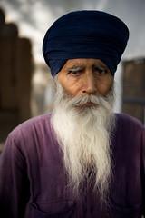 Baldev Singh (gurbir singh brar) Tags: blue india male beard nikon human pensive maharashtra turban sikh nikkor 2010 singh khalsa nanded nihang  flowingbeard gurbirsinghbrar samalsar baldevsinghbrar