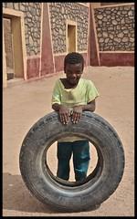 :: Tuareg child :: (Aman Iman ॐ) Tags: africa boy portrait people algeria child nomad ethnic enfant pneu algérie tyre touareg garçon tuareg afrique tamanrasset nomade