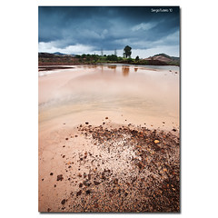 The past of a rock (SergioTudela) Tags: sky espaa cloud mountain reflection sergio rain rock lluvia xpro spain sony riotinto huelva cielo lee reflejo montaa nube roca 2010 carlzeiss rotinto a900 sonyalpha leefilter sonyalphaa900 sonya900 carlzeiss1635 sergiotudela sal1635cz sony1635 sergiotudelacom leexpro09nd leexprofilter