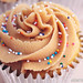 Peanut butter cupcake with peanut butter buttercream frosting, filled with Nutella