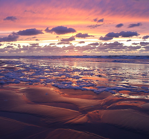 Sunset at ameland beach , original color , with many clouds , waves and sea