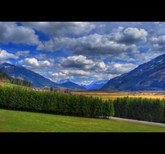 Alps (Sareni) Tags: trees houses sky mountains alps colors grass clouds austria april hdr highdynamicrange 2010 sareni