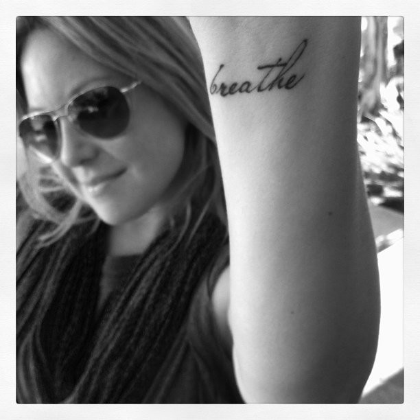 "Brooke Hammerling shows off her ""breathe"" tattoo. Her firm does PR for tons"