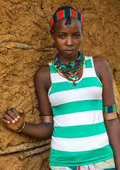 Portrait of a young woman from Hamer tribe, Omo valley, Turmi, Ethiopia (Eric Lafforgue) Tags: adornment africa beads beautifulpeople day decoration developingcountry eastafrica embellishment ethiopia ethiopia0617048 ethiopian ethiopianethnicity ethnic feminine hamar hamer headwear hornofafrica indigenousculture jewelry lookingatcamera necklace omovalley onepersononly onewomanonly onlywomen ornamentation outdoors portrait realpeople shells southernethiopia tribal tribe tribeswoman truepeople turmi vertical waistup woman et