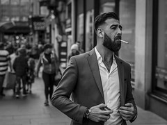 Tailored (Leanne Boulton) Tags: urban street candid portrait portraiture streetphotography candidstreetphotography candidportrait streetportrait streetlife man male face facial expression look feeling mood emotion smoke smoker smoking cigarette sharp tailored suit style stylish fashion beard tone texture detail depthoffield bokeh naturallight outdoor light shade shadow city scene human life living humanity society culture people canon canon5d 5dmarkiii 70mm character ef2470mmf28liiusm black white blackwhite bw mono blackandwhite monochrome glasgow scotland uk