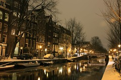 Leidsegracht Canal in the winter, Amsterdam (Fotis Korkokios) Tags: snowflake street bridge houses winter light white snow cold holland ice water windmill beautiful amsterdam bicycle night dark lights boat swan europe iamsterdam darkness district iceskating magic thenetherlands ducks eu tram coffeeshop canals skate xxx snowfall redlight mokum redlightdistrict jordaan 2010 urbanlandscape touristic gracht coffeshop leidsegracht magicalwinter frozenfrost