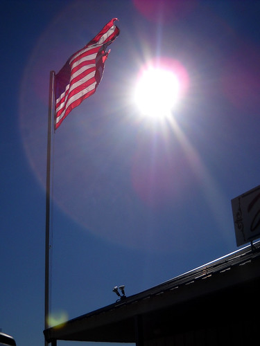 American flag flying in the sunlight