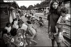 normal day (fly) Tags: people thailand asia bangkok railway earthasia simonkolton