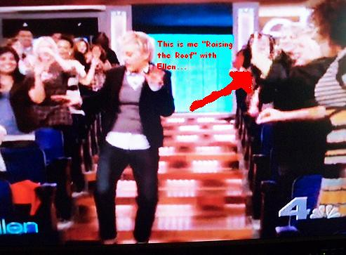 "me trying to get ellen to notice me... i'm ""raising the roof"" in case you don't recognize my mad dance skillz..."