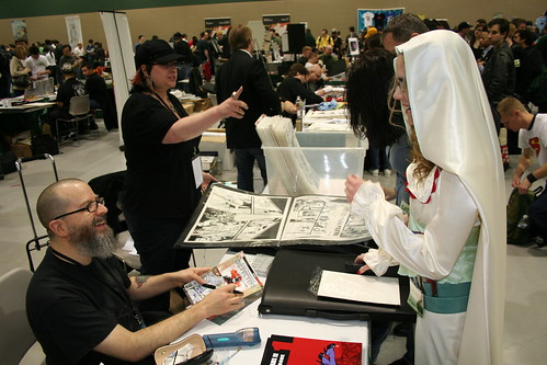 Erica (as Alice) getting her copies of Detective Comics signed by J.H. Williams III.