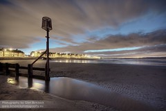 "Return of ""The Lamp"" (~Glen B~) Tags: longexposure houses sea motion reflection beach water night clouds lights coast tide blurred front shore groyne redcar groynes standardlamp granvilleterrace"