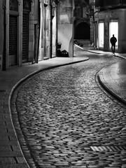 Stone rivers (piriskoskis.) Tags: street people bw man canon 350d girona bn cobblestones curve