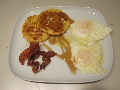 waffles, eggs, bacon, maple syrup