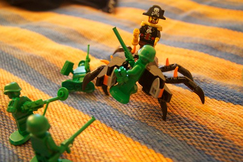 Lego army men fighting a pirate riding on a giant robot crab
