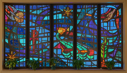 Immacolata Roman Catholic Church, in Richmond Heights, Missouri, USA - stained glass window in narthex with symbols of bapism and the Holy Spirit