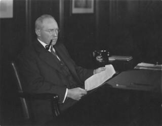 Photograph of Britton Osler at his desk
