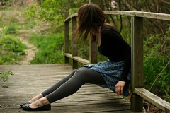 Awake but still I'm dreaming (Jessica Matteazzi) Tags: park bridge woman selfportrait green nature girl grass forest outdoors woods sitting bokeh path skirt breeze bushes leggings explored