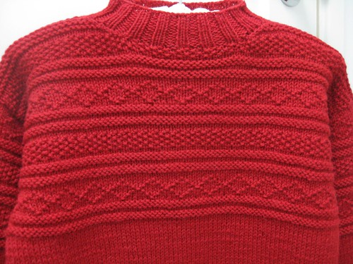 close-up red gansey pullover