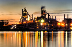 Essar Steel (Billy Wilson Photography) Tags: longexposure chimney lake ontario canada industry wet water night digital canon reflections river landscape eos rebel lights lowlight factory dusk kitlens pollution xs soo liquid hdr highdynamicrange stacks softlight saultstemarie northernontario algoma algomasteel essarsteel orebridge diffractionstars billywilsonphotography blastfurnase