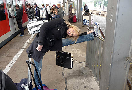 Extra cooling down can be done anywhere - Christina Chitwood at an Obserstdorf, Germany, train station.