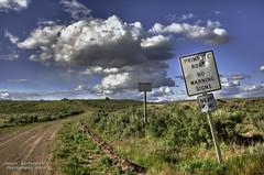 Primitive Road (janusz l) Tags: road trip field sign clouds geotagged desert farm semi bigsky redneck washingtonstate hdr bulletholes primitive janusz leszczynski 002615 geo:lat=47934111 geo:lon=1193418