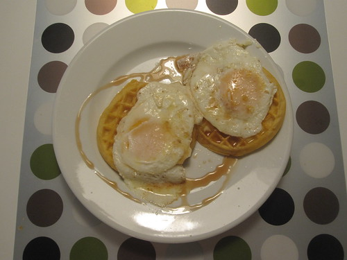 Waffles and eggs, with maple syrup