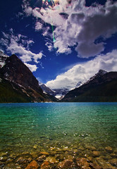 By the Lake (Debbie :))) Tags: blue sun lake canada mountains clouds fleurs landscape rocks aqua ngc scenic alberta lakelouise et paysages polariser ndfilter natureselegantshots