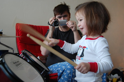 Drumming away.