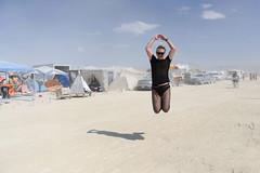 Bye! (naturalturn) Tags: camp usa man jump jumping nevada sage burningman blackrockcity leap 2009 leaping waldemar burningman2009 image:rating=5 sagecamp image:id=080601