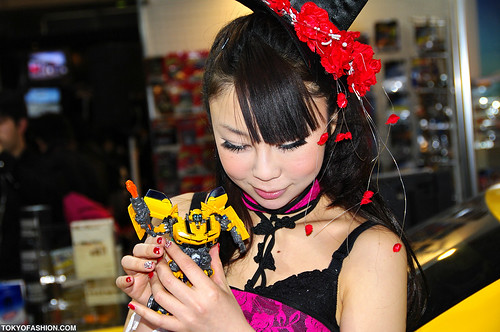 Cute Japanese Girl & Transformer Toy