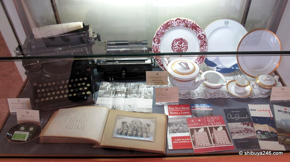 A display showing some of the old photos, china and typewriter that was previously used in the hotel.