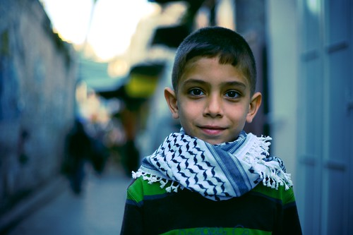 Palestinian boy wearing scarf