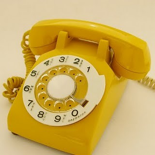 mustard yellow rotary phone by you.