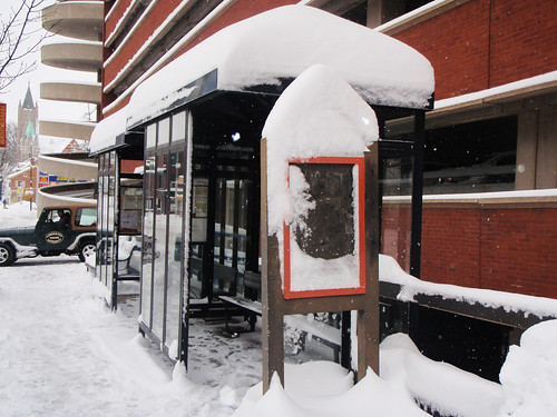 bus stop in downtown lancaster during the february snow storm